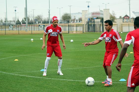 Peter alongside FC Dallas' former player David Ferreira. Photo: Jason Minnick.