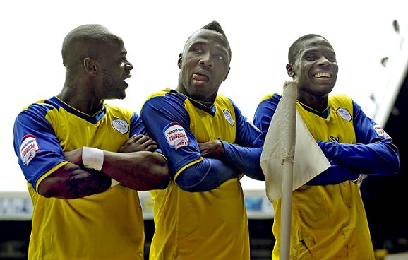 From left to right: Leroy, Jermaine Johnson and Jeremy Helan celebrate Johnson's goal for Sheffield Wednesday at Leeds United in 2013. Photo courtesy of Sheffield Newspapers