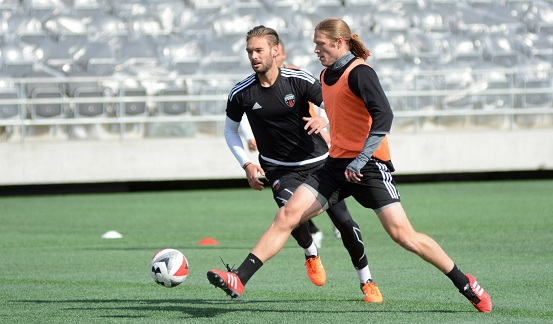 James (in black) and Fury FC teammate Lance Rozeboom train at TD Place on Wednesday, March 30, 2016. Photo: Chris Hofley/Ottawa Fury FC