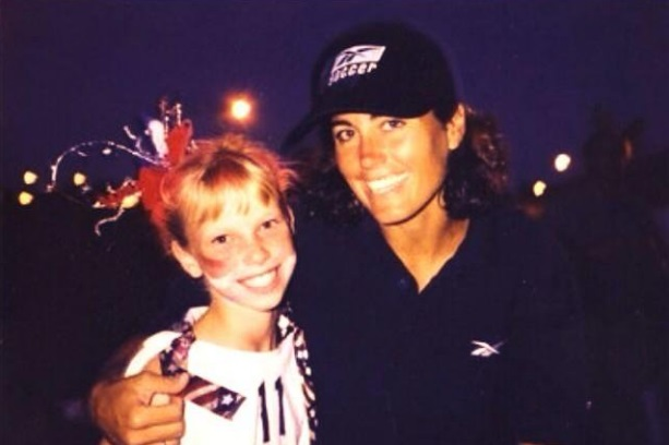 A childhood Michelle meeting USWNT legend Julie Foudy. Photo: Michelle Lomnicki