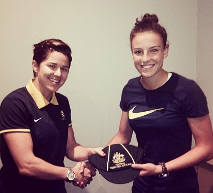 Chloe (right) receiving her international cap from Matildas attacking great Sarah Walsh. instagram.com/chloelogarzo